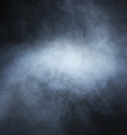 Smoke over black background Stock Photo