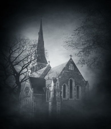 Halloween background with spooky and ancient church over smoky background photo