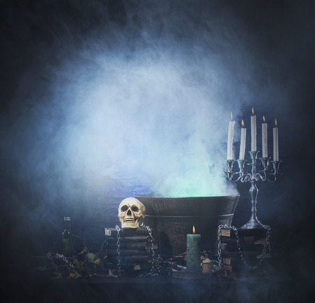 halloween background: Halloween background with a lot of different witchcraft tools: scull, candles, book, poison and smoke Stock Photo