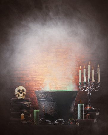 witchery: Halloween background with a lot of different witchcraft tools: scull, candles, book, poison and smoke Stock Photo