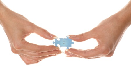 Puzzle in a hand Stock Photo