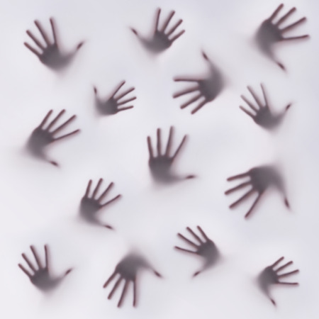 hallow: Frightening silhouette of many different hands Stock Photo