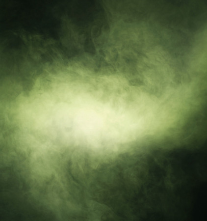 Abstract texture of the green smoke over black background Standard-Bild