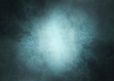 blue grey: Abstract texture of the green smoke over black background Stock Photo