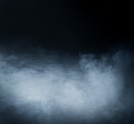 horrors: Smoke over black background Stock Photo