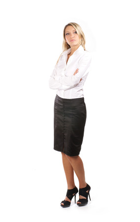 legs folded: Young attractive businesswoman isolated on white