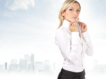 sexy blonde girl: Young attractive businesswoman over urban background Stock Photo
