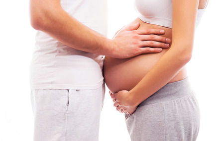 Pregnant woman and her husband isolated on white