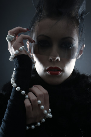 priestess: Portrait of female vampire over dark background