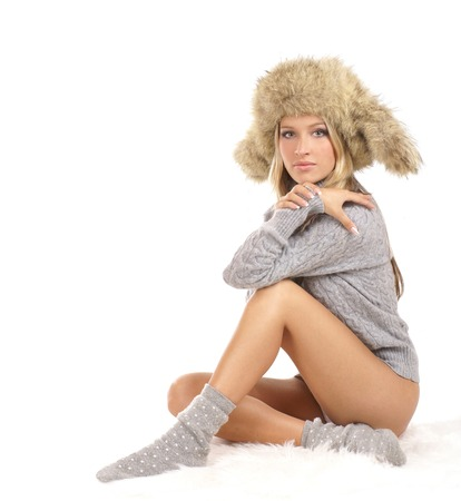 white winter: Young sexy girl in winter dress isolated over white background Stock Photo