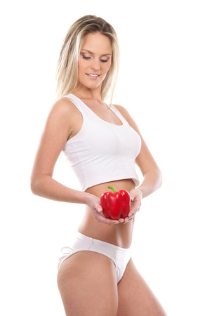belly pepper: Young sexy girl with exotic fruit isolated on white