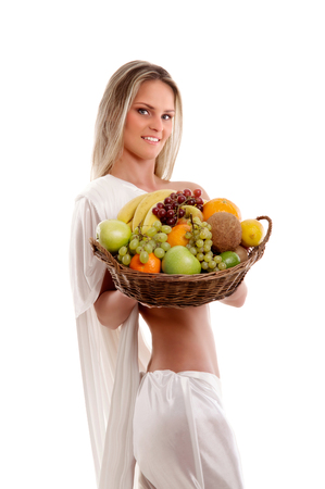 fruits in a basket: Attractive woman with a basket full of fruits