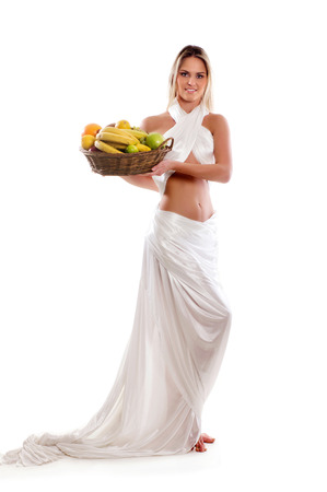 ancient sexy: Attractive woman with a basket full of fruits