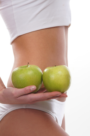 healthy sport: Dieting concept, Beautiful belly and a fruit isolated on white