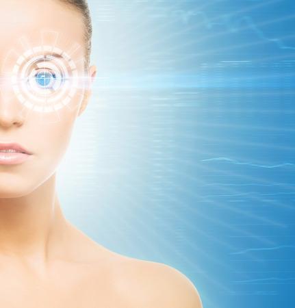 optometry: Young  woman from future with the laser hologram on her eyes (eye scanning technology, optometry and virtual reality concept)