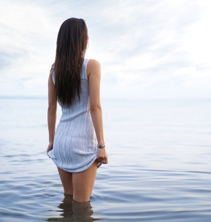 fit girl: Young sexy lady standing in the warm water