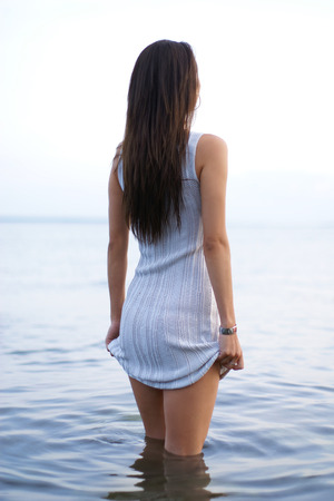 warm water: Young sexy lady standing in the warm water