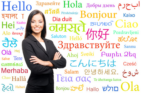 foreign secretary: Young, confident, successful and beautiful business woman over the background with a world languages Stock Photo