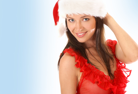 Young sexy Santa over blue Stock Photo
