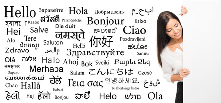 Business woman over the background with a different world languages (foreign language school)