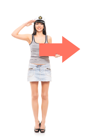 sailor girl: Young, beautiful and sexy sailor girl with a red arrow isolated on white background Stock Photo