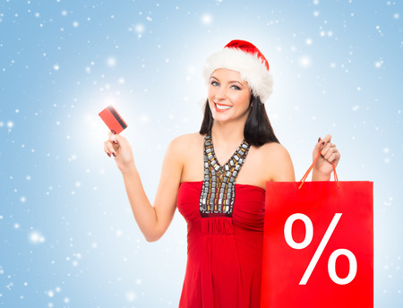 christmas shopper: Christmas shopper woman with a credit card over winter background