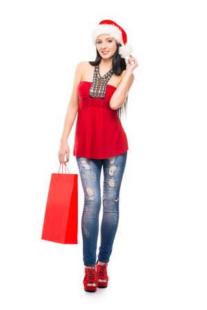 christmas shopper: Young and beautiful Christmas shopper girl isolated on white background