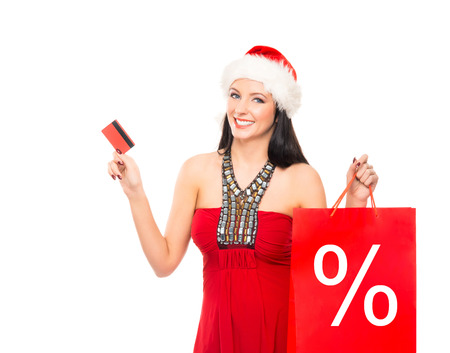 christmas shopper: Christmas shopper woman with a credit card isolated on white Stock Photo