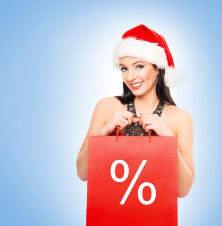 shopper: Christmas shopper woman over winter background Stock Photo