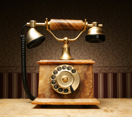landline: Vintage telephone over retro background