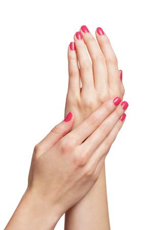 partes del cuerpo humano: Manos femeninas hermosas aisladas en blanco