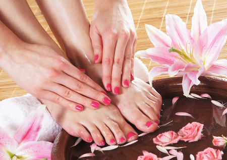 foot spa: Spa background with a beautiful legs, flowers, petals and ceramic bowl
