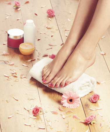 feet naked: Summer spa background with a beautiful legs and flowers