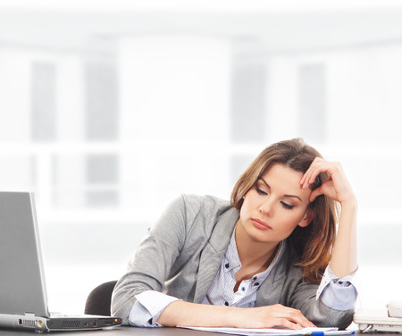 Business woman working in office on white Stock Photo