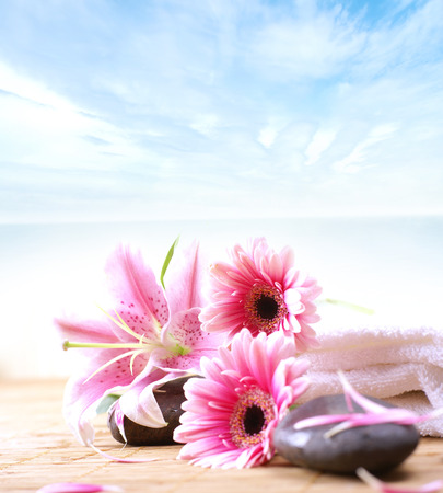 alternative wellness: Spa background of flowers, stones and towel