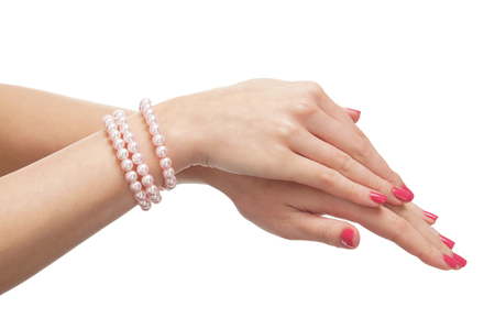 chaplet: Beautiful female hands with the pearl chaplet isolated on white