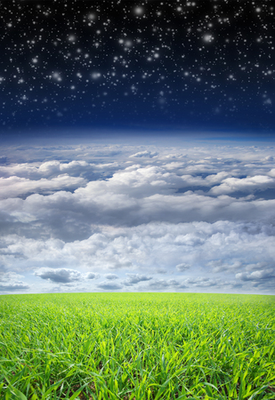 stratosphere: Collage: meadow, sky, clouds, stratosphere and space in one image Stock Photo
