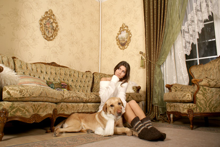 indore: Attractive woman with the dog in ancient interior