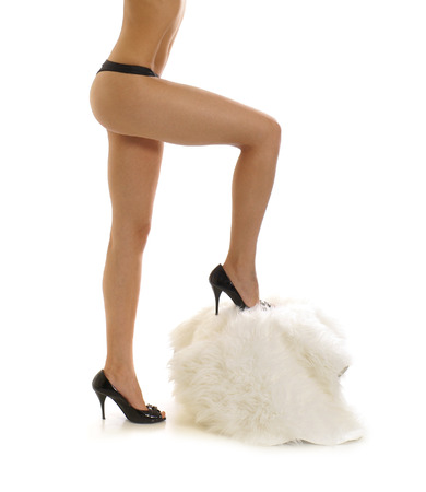 fine legs: Sexy legs of beautiful woman isolated on white Stock Photo