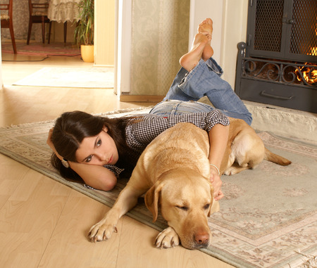indore: Attractive woman with labrador the dog on the flor Stock Photo