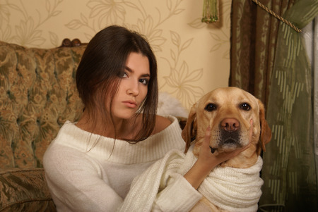 indore: Attractive woman with the dog in the luxury interior