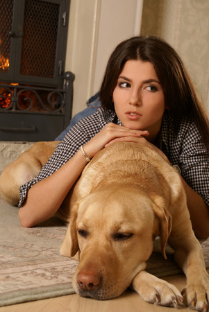 indore: Attractive woman with the dog laying on the flor Stock Photo