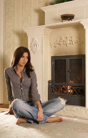 indore: Attractive woman  near the fireplace
