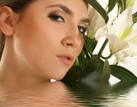 Attractive woman with the lily Stock Photo