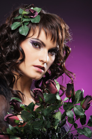 Young attractive woman with the haircut with flowers Stock Photo