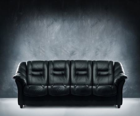 indoor background: Black leather sofa in dramatic interior