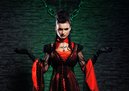 dungeon: Halloween concept: young and sexy lady vampire in the dungeon