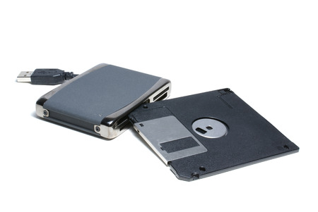mmc: Card reader for cf, ms, ms duo pro, sd, sm, mmc, etc. with 1,5 floppy isolated on white