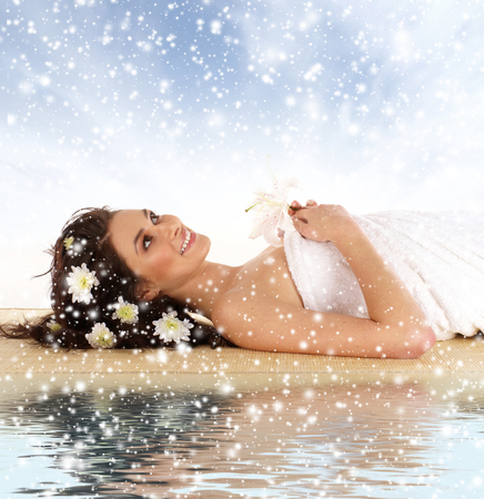 pascuas navideÑas: Attractive woman getting spa treatment isolated on white  (Christmas concet)