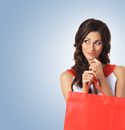 Young beautiful woman with some shopping bag